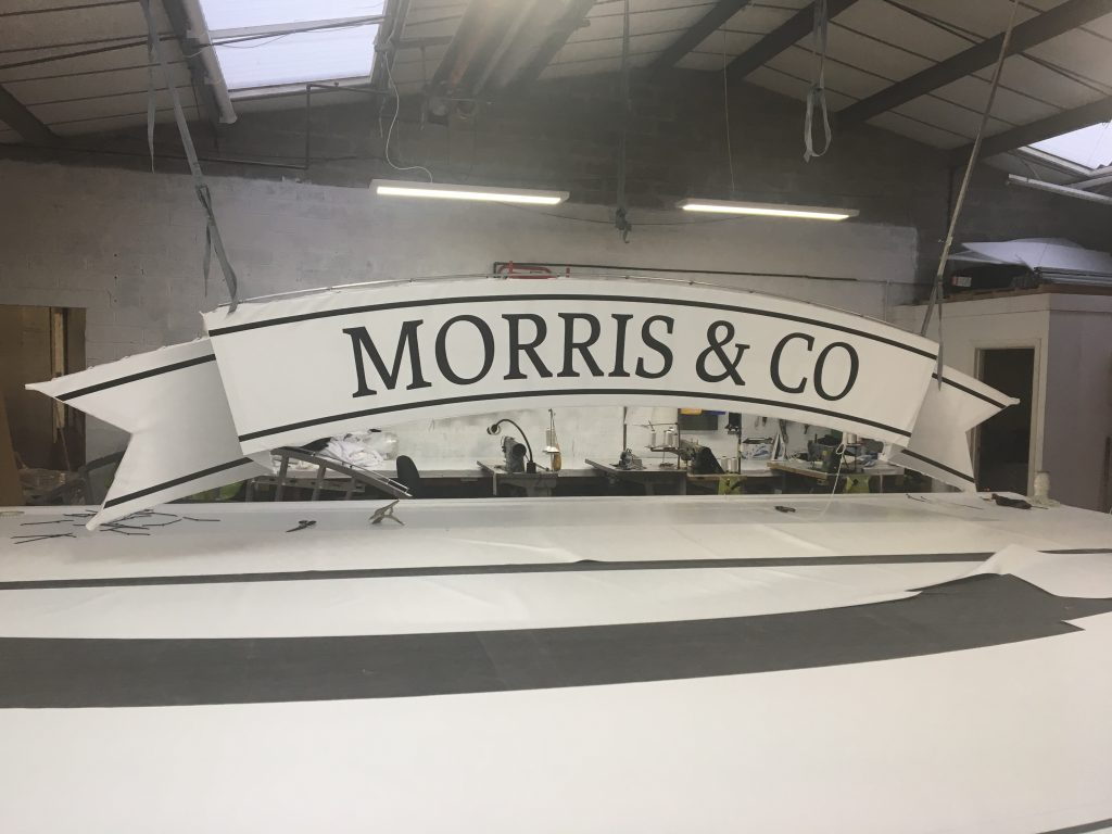 Bespoke Rooftop Banner for Morris and Co by Tensile Fabric Structures Ltd